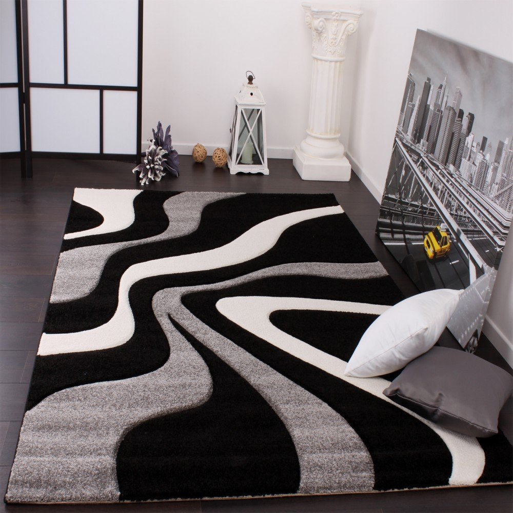 tapis noir et blanc design id es de d coration. Black Bedroom Furniture Sets. Home Design Ideas