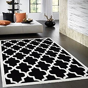 Tapis de salon noir et blanc 2 id es de d coration for Decoration quadrilobe